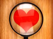 Heart Shape in the Magnifying Glass on the Wooden Background